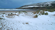 A wintery scene looking out from the dunes to Down End.  Courtesy of Neville Stanikk.